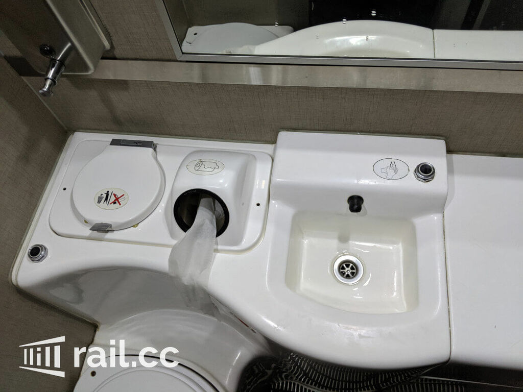Basin with soap and toilet paper